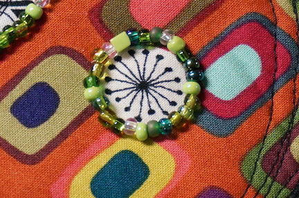 WS circles with green beads detail
